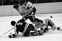 Seals vs Boston: 1973 Seals Reggie Leach and Bob Stewart battle Bruins John Bucyk. (photo by Ron Riesterer)