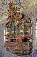 Baroque organ with 2,000 pipes built 1733 by Fray Manuel de Sao Bento, with chinoiserie elements painted by Gabriel Ferreira da Cunha in 1737, in Sao Miguel Chapel, or St Michael's Chapel, designed in Manueline style 1517-22 by Marco Pires and completed by Diogo de Castilho, on the site of a 12th century chapel in the University of Coimbra, Coimbra, Portugal. The chapel was renovated in the 17th and 18th centuries, with pulpit built by Manuel Ramos in 1684, ceiling painted by Francisco F de Araujo, tiled floor added 1613, Baroque organ with 2,000 pipes built 1733 by Fray Manuel de Sao Bento, chinoiserie painting by Gabriel Ferreira da Cunha in 1737, and Mannerist altarpiece designed by Bernardo Coelho in 1605 and made by sculptor Simon Mota, with paintings by Simon Rodrigues and Domingos Vieira Serrao. The University of Coimbra was first founded in 1290 and moved to Coimbra in 1308 and to the royal palace in 1537. The building is listed as a historic monument and a UNESCO World Heritage Site. Picture by Manuel Cohen