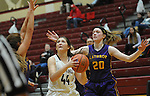 Ketchikan's Kyra Welker looks for a shot against the defense of Olivia Kraska in their Dimond Lady Lynx Prep Shootout basketball game Friday, February 10, 2017.  Photo for the Daily News by Michael Dinneen