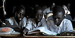 Students share a book in a classroom in Malakal, Southern Sudan.