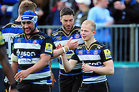 Will Homer of Bath Rugby is congratulated on his try by team-mates. Aviva Premiership match, between Bath Rugby and Sale Sharks on April 23, 2016 at the Recreation Ground in Bath, England. Photo by: Patrick Khachfe / Onside Images