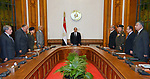 Egyptian President Abdel Fattah al-Sisi and members of the national defense council mourn for the victims of Sunday's two church attacks, in Cairo April 9, 2017. Abdel-Fattah al-Sisi on Sunday evening declared a three-month state of emergency in Egypt after two church blasts killed at least 44 people and injured 120 others. Photo by Egyptian President Office