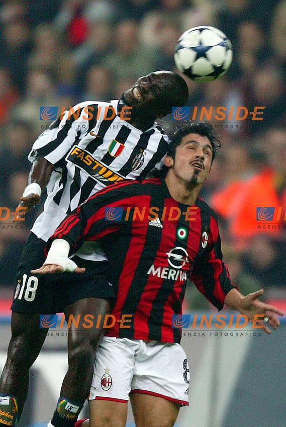 Milano 1/11/2003 <br /> Milan Juventus 1-1<br /> Stephan Appiah (Juventus) Gennaro Gattuso (Milan)<br /> Foto Baroncini/Insidefoto