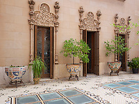 The stucco and paintings around the impressive inner courtyard are the work of Thomas Bergada and continue the floral theme which is evident throughout the house