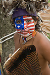 Portrait young Native American with the American flag ( a take off on Captain America ) painted on his face at Thunderbird Pow-Wow in Queens County Farm, New York.<br /> <br /> His regalia is an example of ethnic pride and heritage a celebration of all Native Americans.