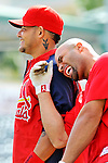 3 March 2011: St. Louis Cardinals' first baseman Albert Pujols has a laugh with teammate Yadier Molina prior to a Spring Training game against the Washington Nationals at Roger Dean Stadium in Jupiter, Florida. The Cardinals defeated the Nationals 7-5 in Grapefruit League action. Mandatory Credit: Ed Wolfstein Photo