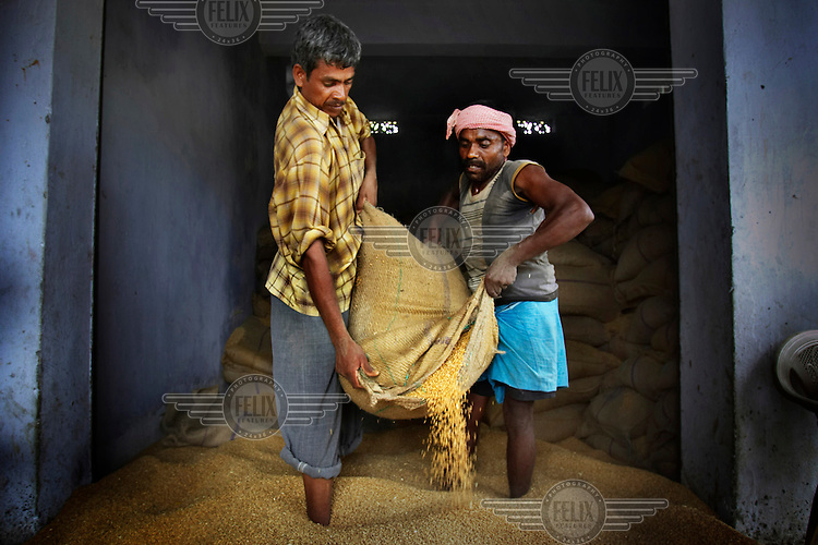 A store of grain at a government aid distribution point during the 2007 South Asian floods. Millions have been affected by severe flash flooding following particularly heavy monsoon rains across South Asia. Over 12 million residents have been displaced in India alone and many have lost their lives during the crisis. Bihar was one of the worst hit states and, although several aid agencies have been working to help the flood victims, the distribution of relief supplies has been hampered by floodwaters and badly damaged highways.