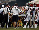 Emergency Medical personnel remove Denver Broncos defensive end Derek Wolfe after he was injured against the Seattle Seahawks at CenturyLink Field in Seattle, Washington on  August 17, 2013. The Seattle Seahawks beat the Broncos 40-10.     ©2013. Jim Bryant Photo. All Rights Reserved.