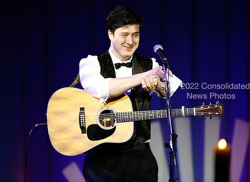 Lead singer of the band Mumford &amp; Sons, Marcus Mumford performs during a state dinner, hosted by U.S. President Barack Obama for British Prime Minister David Cameron, at the South Lawn of the White House March 14, 2012 in Washington, DC. Prime Minister Cameron was on a three-day visit in the U.S. and he had talks with President Obama earlier the day.  .Credit: Brendan Hoffman / Pool via CNP