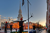 Pumpkin head men in downtown Portsmouth