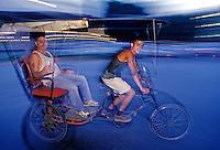 Pedicab in motion, male rider, Havana Cuba, Republic of Cuba,