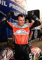 Nov. 13, 2011; Pomona, CA, USA; NHRA pro stock motorcycle rider Eddie Krawiec celebrates after clinching the 2011 championship during the Auto Club Finals at Auto Club Raceway at Pomona. Mandatory Credit: Mark J. Rebilas-.
