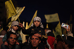 Palestinian supporters of Fatah movement hold the party's torch during a rally in Gaza city on December 31, 2013. Tens of thousands of Fatah supporters rallied in Gaza City on Tuesday to celebrate the 49th anniversary of the Palestinian nationalist movement's founding. Photo by Ashraf Amra