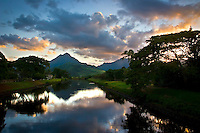 Sunset at the Kawai Nui Marsh canal with a view of the Ko'olau mountains in Kailua, Windward O'ahu.