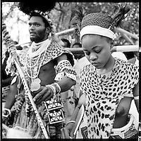 A couple take part in a mass wedding ceremony at the Nazareth Baptist Church headquarters near KwaMashu, KwaZulu Natal, August 2 1998. The founder Isaiah Shembe is seen as a spiritual descendent of Moses and Jesus, and the church embraces traditional Zulu values and customs. Photo Greg Marinovich