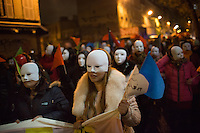 Women of Chinese descent concealed by masks, representing  sex workers in Paris, seen on Boulevard de la Chapelle, take part in a demonstration on the International Day to End Violence Against Sex Workers. Chinese sex workers in Paris, who are usually here without legal papers, often experience violence and harassment on the streets from clients and even police. Paris, France. Dec. 17, 2014