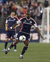 New England Revolution midfielder Kalifa Cisse (4) controls the ball at midfield. In a Major League Soccer (MLS) match, the New England Revolution (blue) tied New York Red Bulls (white), 1-1, at Gillette Stadium on May 11, 2013.