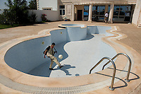 A rebel fighter kicks a football in an empty swimming pool in the grounds of a house owned by Muhammad Matuq, Secretary for Public Works under Colonel Gaddafi, and one of the suspects in the killing of British policewoman Yvonne Fletcher outside the Libyan embassy in London in 1984. A rebel force raided the house, in the Tripoli suburb of Qasr ben Ghashir, where some of Gaddafi's soldiers had made a base, but on arrival they found the building already abandoned. In February 2011 an armed revolution broke out in Libya and after six months of fighting it appears that Gaddafi's 42 year regime has come to an end while the former dictator is currently on the run.