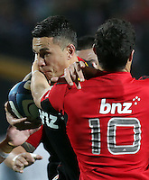 Chiefs' Sonny Bill Williams is tackled by Crusaders' Dan Carter in the semi-final Super Rugby match, Waikato Stadium, Hamilton, New Zealand, Friday, July 27, 2012.  Credit:SNPA / David Rowland