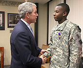 Washington, DC - December 20, 2007 -- United States President George W. Bush shakes the hand of United States Army Private First Class (PFC) Demario Hicks of Fort Stewart, Georgia, Thursday, December 20, 2007, after presenting him with a Purple Heart during his visit to Walter Reed Army Medical Center in Washington, D.C., where the soldier is recovering from injuries suffered in Operation Iraqi Freedom.  .Credit: Joyce N Boghosian - White House via CNP