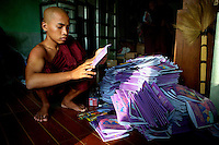 A monk from the Myazeda Man Oo Monastery, where they produce promotional material and literature for the Buddhist nationalist 969 movement, prepares pamphlets on a controversial new proposed marriage law putting restrictions on Muslim men marrying Buddhist women, in Mawlamyine, Mon State. /Felix Features