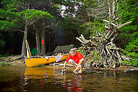 Algonquin Park, Ontario, Canada, July 2006. Some campsites represent little paradises where one can enjoy the bonfire after a hard day of paddling. The Algonquin Provincial Park consists of many lakes that can be explored by canoe and which are connected by portages. Photo by Frits Meyst/Adventure4ever.com