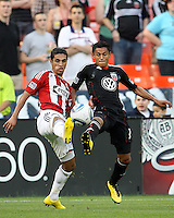Andy Najar #14 of D.C. United goes for the ball with Mariano Trujillo #8 of Chivas USA during an MLS match at RFK Stadium, on May 29 2010 in Washington DC. United won 3-2.