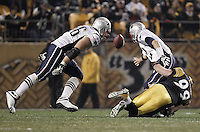 PITTSBURGH, PA - OCTOBER 30:  Brett Keisel #99 of the Pittsburgh Steelers tackles and strips the ball from Tom Brady #12 of the New England Patriots during their last drive of the game during the game on October 30, 2011 at Heinz Field in Pittsburgh, Pennsylvania.  (Photo by Jared Wickerham/Getty Images)