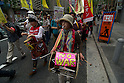 June 5, 2011- A women beats a drum with a 'No War' placard at a Anti-Nuclear demo held in Shinbashi, Tokyo, Japan. Around 200 left-wing protesters marched in front of the TEPCO's Shinbashi office chanting 'No Nukes, No more Hiroshima, No more Nagasaki and no more lies'. (Photo by B.Meyer-Kenny/2.0 Images)