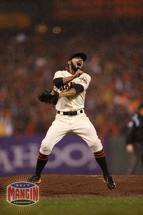 SAN FRANCISCO - OCTOBER 22:  Sergio Romo of the San Francisco Giants pitches in the rain during Game 7 of the NLCS against the St. Louis Cardinals at AT&T Park on October 22, 2012 in San Francisco, California. (Photo by Brad Mangin)
