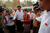 Aung San Suu Kyi gestures as she arrives to visit a polling station in Kawhmu township where she stands as a candidate in parliamentary by-elections April 1, 2012. Myanmar votes on Sunday in its third election in half a century, a crucial test of its nascent reform credentials that could propel opposition leader Aung San Suu Kyi into parliament and convince the West to end sanctions. REUTERS/Damir Sagolj (MYANMAR)