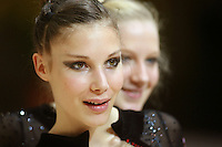 Nathalie Fauquette of France smiles with French rhythmic group, plus solo portraits before competition at 2006 Thiais Grand Prix in Paris, France on March 25, 2006.  (Photo by Tom Theobald)