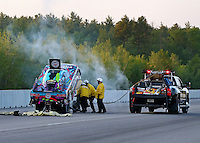 Jun 3, 2016; Epping , NH, USA; NHRA safety safari crews put a fire out on the car of funny car driver Courtney Force during qualifying for the New England Nationals at New England Dragway. Mandatory Credit: Mark J. Rebilas-USA TODAY Sports