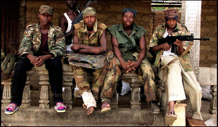 PIC BY HEATHCLIFF O'MALLEY.YOUNG WESTSIDE BOYS IN THE RECENTLY RETAKEN TOWN OF MASIAKA WHICH SAW FIGHTING UP UNTIL YESTERDAY,THE REBEL R.U.F ARE STILL ONLY A FEW KILOMETERS AWAY.15/5/00