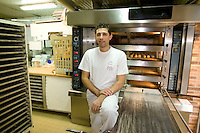 Anis Bouabsa, winner of the Best Baguette in Paris prize for 2008, poses for the photographer in his bakery, Au Duc de la Chapelle in the 18th arrondissement of Paris, France, 21 January 2008.