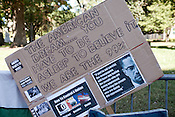 October 21, 2011. Raleigh, NC.. A sign on the fences that surround the Capitol building.. Many supporters of the Occupy Wall Street protestors have been camping out on the sidewalk outside the State Capitol building to show solidarity with those around the globe.