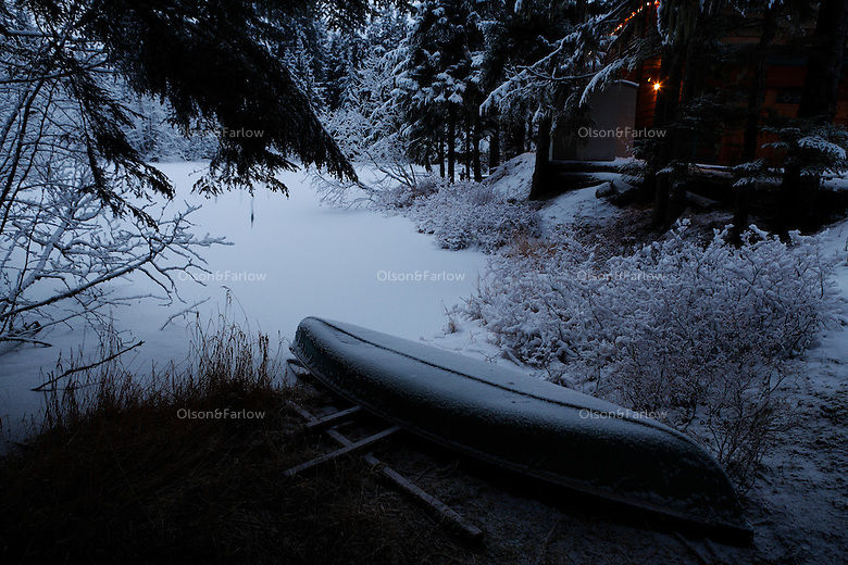 Morning snow on trees and a canoe at Pearson's Pond near Mendenhall Glacier.