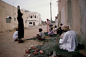 Salalah, Oman.July 2001..Repairing fishing nets.