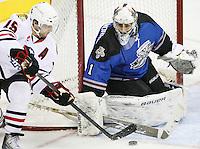 San Antonio Rampage goaltender Dov Grumet-Morris, right, makes a save on Rockford Icehogs' Brett McLean during the first period of an AHL hockey game, Saturday, Jan. 14, 2012, in San Antonio. (Darren Abate/pressphotointl.com)