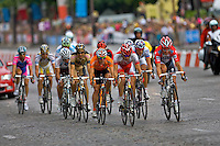Professional Cofidis cyclist Remi Pauriol (Cofidis) leads a small breakaway which takes a huge 15 second lead on the main peleton with just 2 laps to go on the Champs Elysees in Paris during the 2010 Tour de France