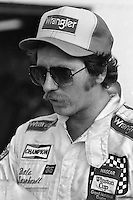 DAYTONA BEACH, FL - FEBRUARY 14: Dale Earnhardt, driver of the Bud Moore Ford, walks through the garage area before practice for the NASCAR Winston Cup race at the Daytona International Speedway in Daytona Beach, Florida, on February 14, 1982.