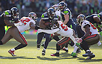 Seattle Seahawks Running back Robert Turbin runs through the tackles of Tampa Bay Buccaneers defensive end William Gholston (92) and linebacker Mason Foster (59) in the second quarter at CenturyLink Field in Seattle, Washington on  November 3, 2013.  The Seahawks beat the Buccaneers 27-24 in overtime. ©2013. Jim Bryant. All Rights Reserved.
