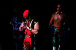 Lucha Libre AAA wrestler Abismo Negro, left, prepares backstage before a match in San Jose, CA March 29, 2009.