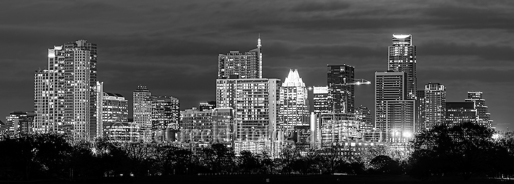 This is an panorama image in black and white of the Austin skyline at night from a location where you can still this wonterful cityscape of downtown.  This cityscape shows the latest skyline of the downtown area of the city as the high rise buildings are all lit up on this evening.  You can also still see the frost and the 360 Condo alongs with the Austonian along with many new skyscrapers added in the last few years to  our cities skyline at least for now.