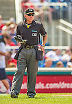 27 July 2013: MLB Umpire Lance Barksdale reaches for a new ball during a game between the New York Mets and the Washington Nationals at Nationals Park in Washington, DC. The Nationals defeated the Mets 4-1. Mandatory Credit: Ed Wolfstein Photo *** RAW (NEF) Image File Available ***