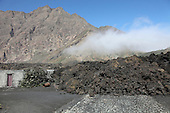 Aa lava flow from Fogo Volcano burying building and road, Portela, Cape Verde