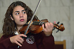 Fernanda Gonzalez plays a violin during music class in the Lydia Paterson Institute in El Paso, Texas. Most of the school's students travel across the border every day from their homes in Juarez, Mexico, to study at the United Methodist-sponsored high school.