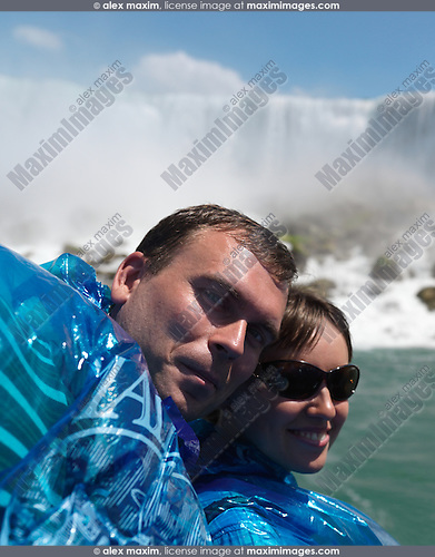 Happy young couple at Niagara Falls, Maid of the Mist boat ride