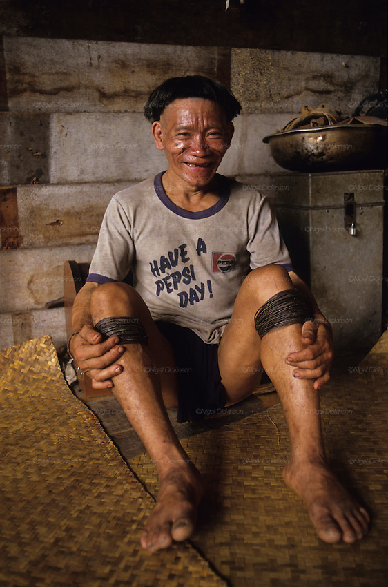 1989: Old Penan native, Sinan, wearing a Pepsi T-shirt. Long Napir, Limbang district, Sarawak, Borneo <br />