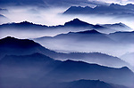 Forested ridges and fog-enshrouded valleys of the Cascade Mountains, Washington.